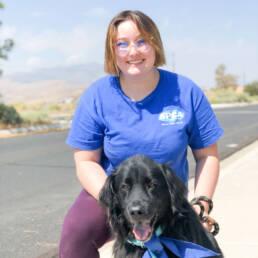 Kat posing with beautiful black dog