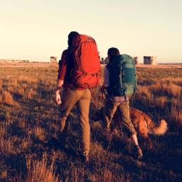 couple hiking together with dog