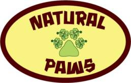 Logo for Natural Paws, pawprint with hawaiian flowers.