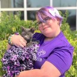 Devon holding grey kitten.